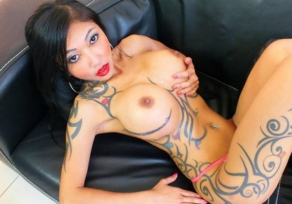 This tattooed maven has got enormous and bouncy breasts.